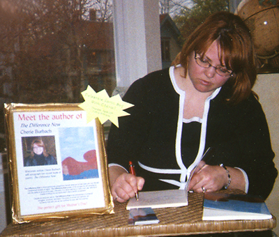 the author signs